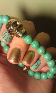 teal and gold mani nail art