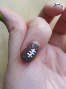 To get the textured football, just add dots of a matte top coat! (Or a brown matte polish.)
